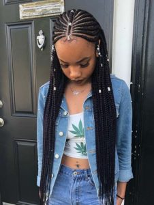 Hip-Length Tribal Braids With Silver Jewelry