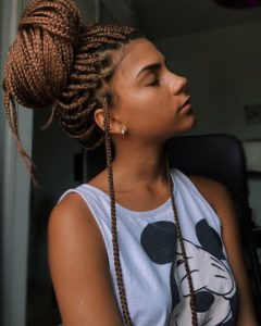 light brown box braids high bun