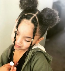 Double Buns With Twisted Bangs