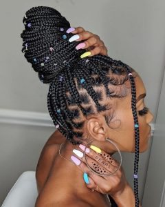 rubber band box braids in a bun with colorful beads