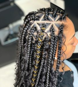 pencil-sized triangle box braids with gold string