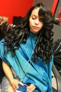 long bouncy curls sew in