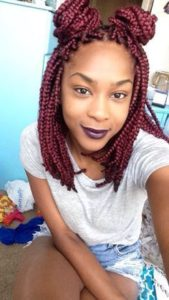 red bob braids with double buns