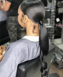 Sleek Low Ponytail With Styled Sideburns