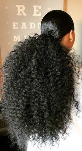Voluminous Curly Low Ponytail