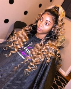black to blonde ombre half up half down sew in with curls