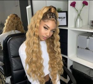 curly blond half up down sew in with feed in braids