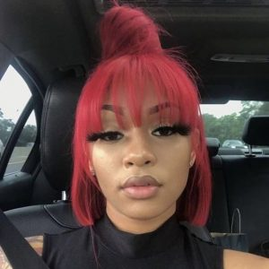 dark red half up half down sew in with bun and bangs