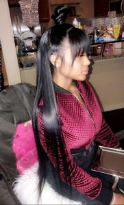 long half up half down sew in with straight bangs